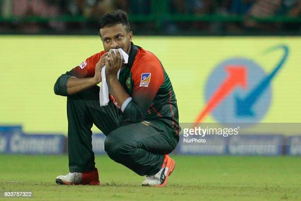 Bangladesh cricket captain Shakib Al Hasan reacts after the defeat against Indian cricket team during the final Twenty20 cricket match of NIDAHAS...