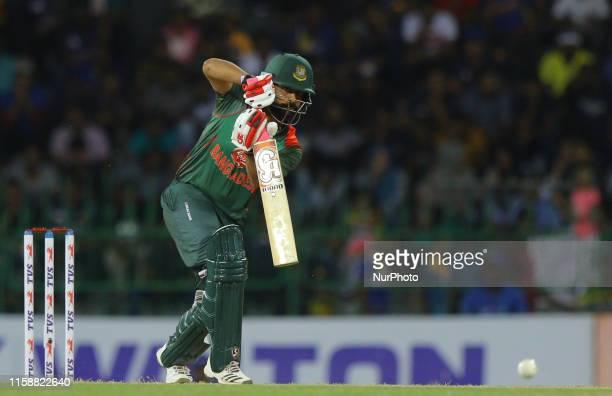 Bangladesh cricket captain Tamim Iqbal plays a shot during the 3rd One Day International cricket match between Sri Lanka and Bangladesh at R...