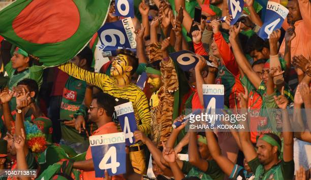 Bangladesh cricket fans cheer in support of their national team during the one day international Asia Cup cricket match between Bangladesh and...