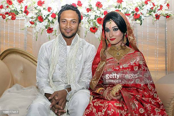 Bangladesh cricket player Shakib al Hasan and his wife Umme Ahmed Shishir pose for a photo during their wedding ceremony in Dhaka on December 12 2012...