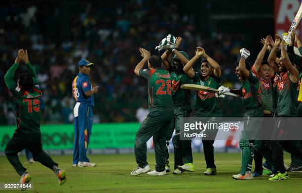 Bangladesh cricket team and management staff dance in celebration after their victory over Sri Lanka during the 6th T20 cricket match of NIDAHAS...