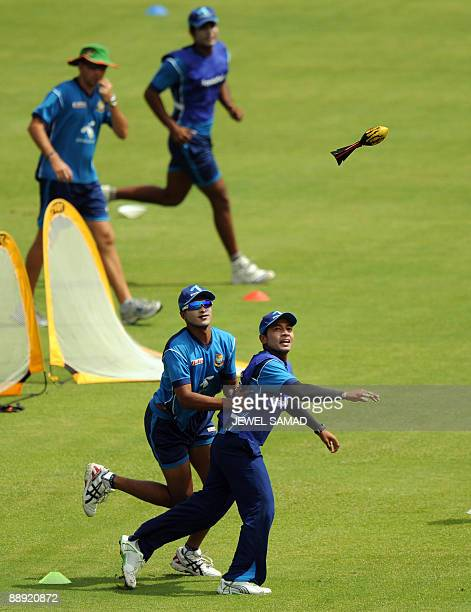 Bangladesh cricket team captain Mashrafe Mortaza and Mushfiqur Rahim warm up with teammates before the start of the first Test match between West...