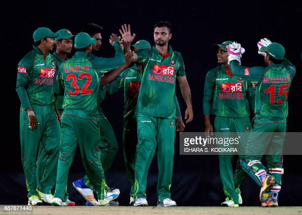 Bangladesh cricket team captain Mashrafe Mortaza celebrates with teammates after he dismissed Sri Lankan batsman Sachith Pathirana during the first...