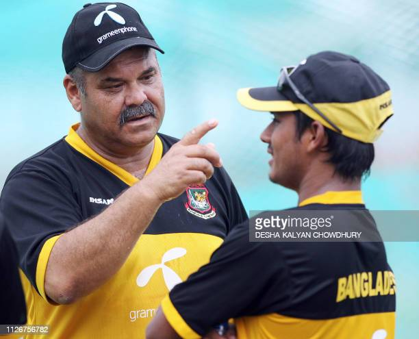 Bangladesh cricket team coach Dev Whatmore speaks to player Mohammad Ashraful during a practice session at the Ruhul Amin Cricket Stadium in...