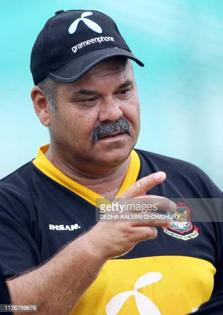 Bangladesh cricket team coach Dev Whatmore speaks to unseen players during a practice session at the Ruhul Amin Cricket Stadium in Chittagong 17 May...