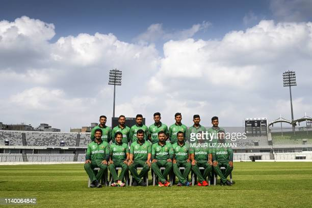 Bangladesh cricket team members pose for photographs as they wear the team official jersey at The Sher-e-Bangla National Cricket Stadium in Dhaka on...