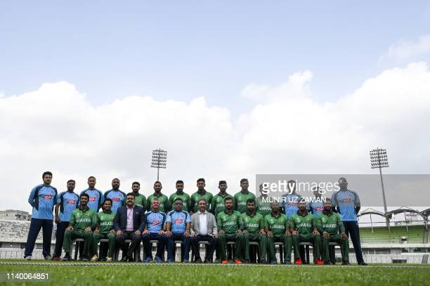 Bangladesh cricket team members pose for photographs as they wear the team official jersey at The ShereBangla National Cricket Stadium in Dhaka on...