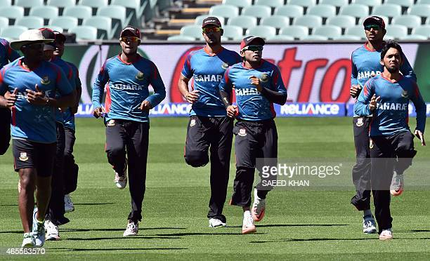 Bangladesh cricket team players busy in warm up exercises during a training session ahead of their 2015 Cricket World Cup Pool A match against...