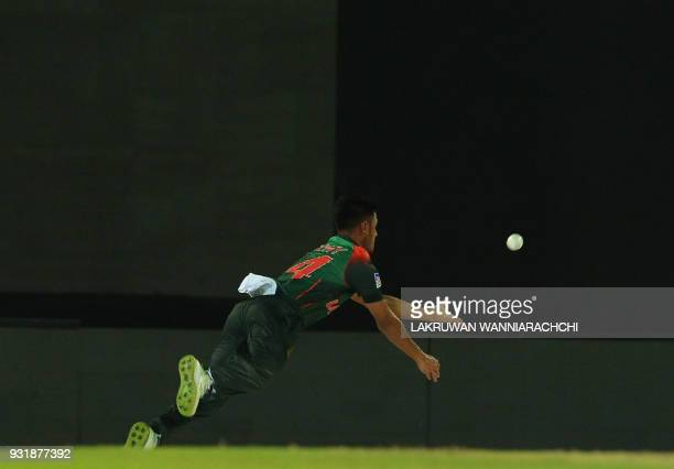 Bangladesh cricketer Abu Hider Rony drops a catch off Indian cricket captain Rohit Sharma during the fifth Twenty20 international cricket match...