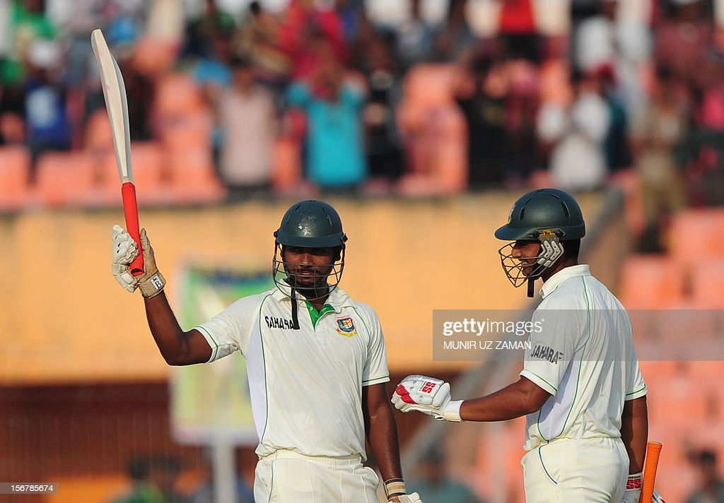 Bangladesh cricketer Abul Hasan (L) acknowledges the crowd after scoring a half century as teammate Mohammad Mahmudullah (R) looks on during the first day of the second cricket Test match between Bangladesh and The West Indies at the Sheikh Abu Naser Stadium in Khulna on November 21, 2012. AFP PHOTO/ Munir uz ZAMAN