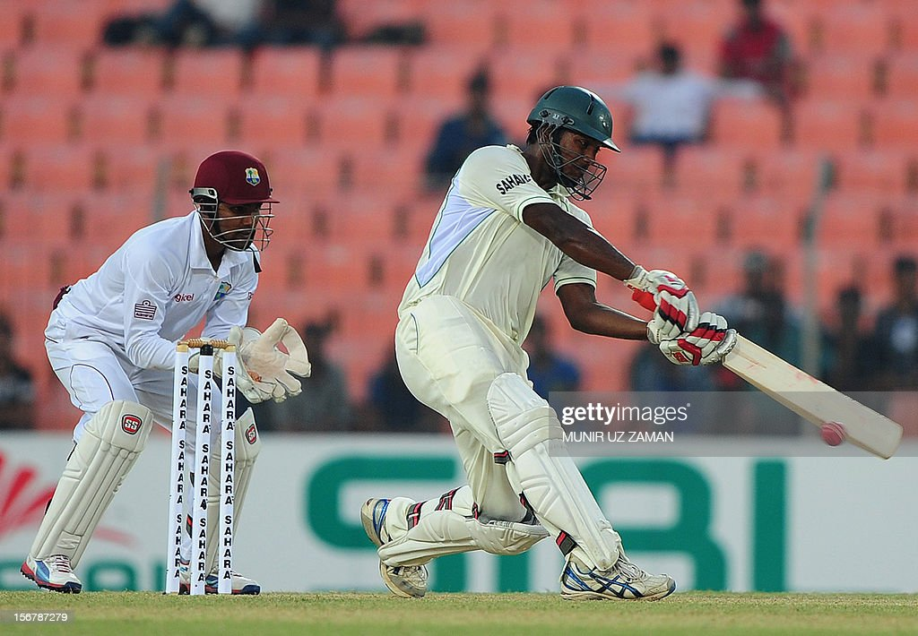 Bangladesh cricketer Abul Hasan (R) plays a shot as West Indies wicketkeeper Denesh Ramdin (L) looks on during the first day of the second cricket Test match between Bangladesh and The West Indies at the Sheikh Abu Naser Stadium in Khulna on November 21, 2012. AFP PHOTO/ Munir uz ZAMAN