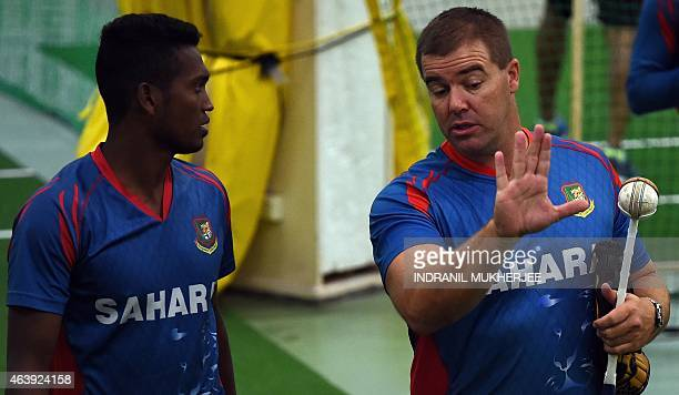 Bangladesh cricketer Al-Amin Hossain listens to bowling coach Heath Streak during an indoor training session ahead of their 2015 Cricket World Cup...
