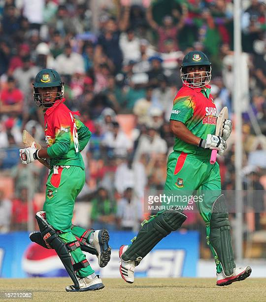 Bangladesh cricketer Anamul Haque and Tamim Iqbal run between the wickets during the first one day international cricket match between Bangladesh and...