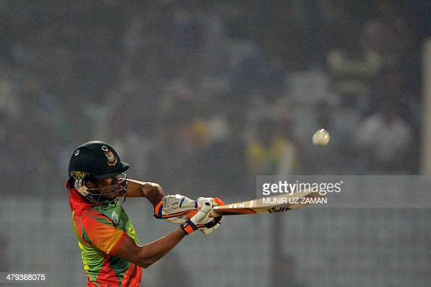 Bangladesh cricketer Anamul Haque plays a shot during the ICC Twenty20 World Cup sixth qualifying cricket match between Bangladesh and Nepal at the...
