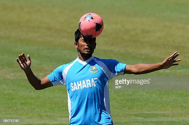Bangladesh cricketer Anamul Haque plays football during a practice session at The Pallekele International Cricket Stadium in Pallekele on March 27...
