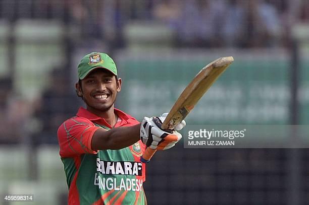 Bangladesh cricketer Anamul Haque reacts after scoring a half century during the third oneday international match between Bangladesh and Zimbabwe at...