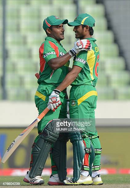 Bangladesh cricketer Imrul Kayes celebrates his half century with teammate Anamul Haque during the eighth match of the Asia Cup oneday cricket...