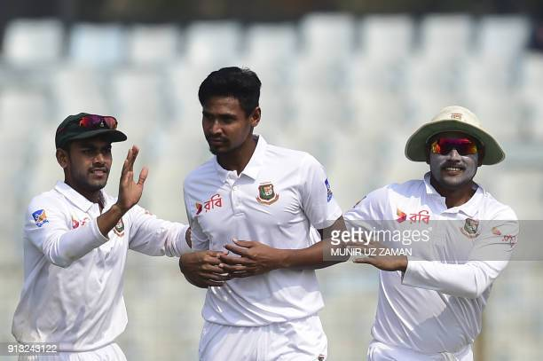 Bangladesh cricketer Imrul Kayes congratulate teammate Mustafizur Rahman after the dismissal of the Sri Lanka cricketer Dhananjaya de Silva during...