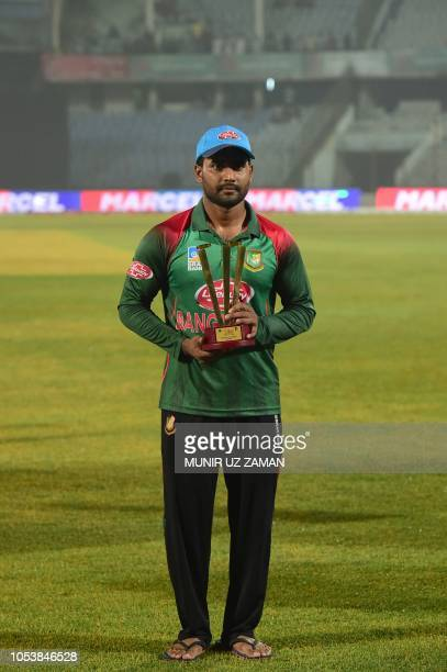 Bangladesh cricketer Imrul Kayes poses with his man of the series award following the presentation ceremony after victory in the third one day...