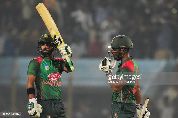 Bangladesh cricketer Liton Das celebrates his half century with teamamte Imrul Kayes during the second one day international cricket match between...