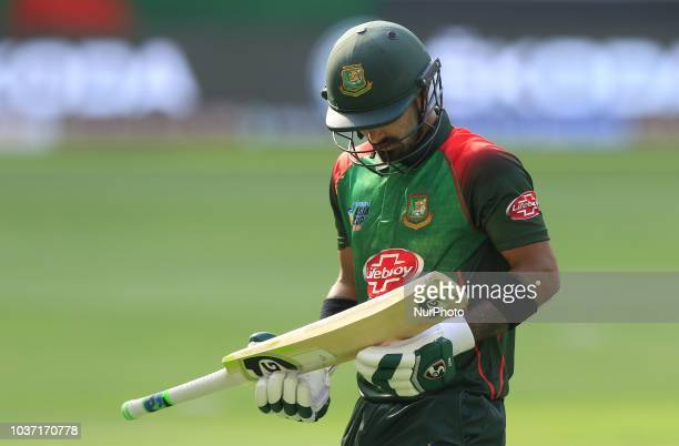 Bangladesh cricketer Liton Das walks back to the pavilion following his dismissal during the 1st cricket match of the Super four group of Asia Cup...