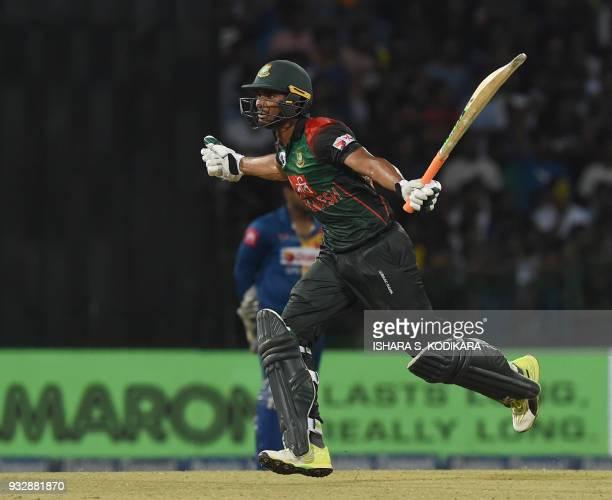 Bangladesh cricketer Mahmudull reacts after scoring the winning run to defeat Sri Lanka by 2 wickets during the sixth Twenty20 international cricket...
