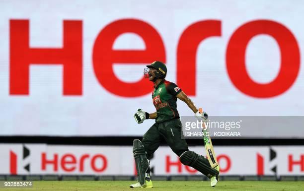 TOPSHOT Bangladesh cricketer Mahmudull reacts after scoring the winning run to defeat Sri Lanka by 2 wickets during the sixth Twenty20 international...