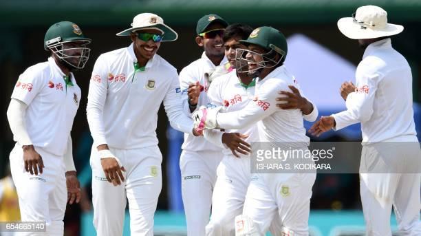 Bangladesh cricketer Mehedi Hasan and captain Mushfiqur Rahim celebrate with teammates after dismissing Sri lanka's Upul Tharanga during the fourt...