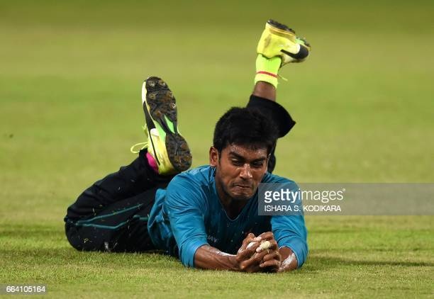 Bangladesh cricketer Mehedi Hasan catches the ball during a practice session at R Premadasa Stadium in Colombo on April 3 on the eve of their first...