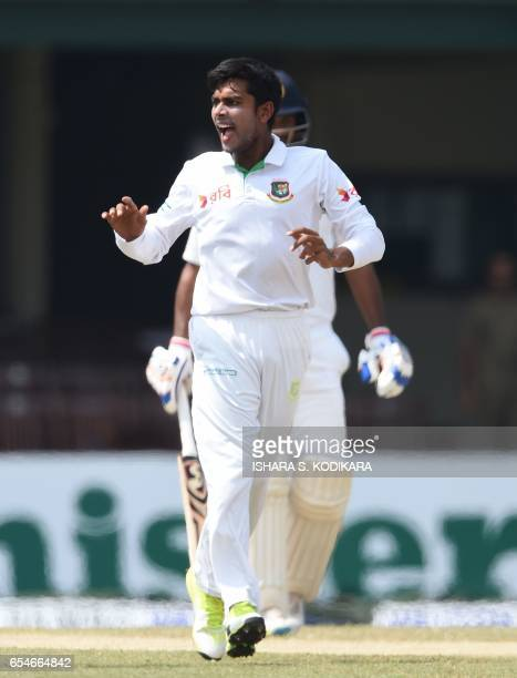 Bangladesh cricketer Mehedi Hasan celebrates after dismissing Sri Lankan cricketer Upul Tharanga during the fourt day of the second and final Test...