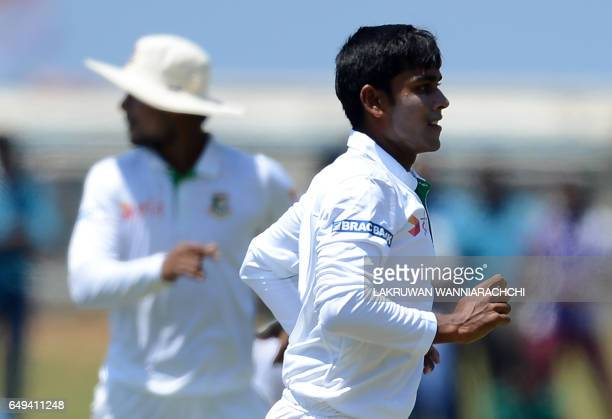 Bangladesh cricketer Mehedi Hasan celebrates after he dismissed Sri Lankan batsman Kusal Mendis during the second day of the opening Test cricket...