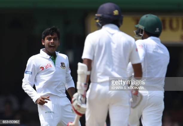 Bangladesh cricketer Mehedi Hasan celebrates after he dismissed Sri Lankan cricketer Kusal Mendis during the first day of the second and final Test...