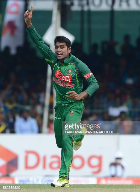 Bangladesh cricketer Mehedi Hasan celebrates after he dismissed Sri Lankan batsman Danushka Gunathilaka during the third and final one day...