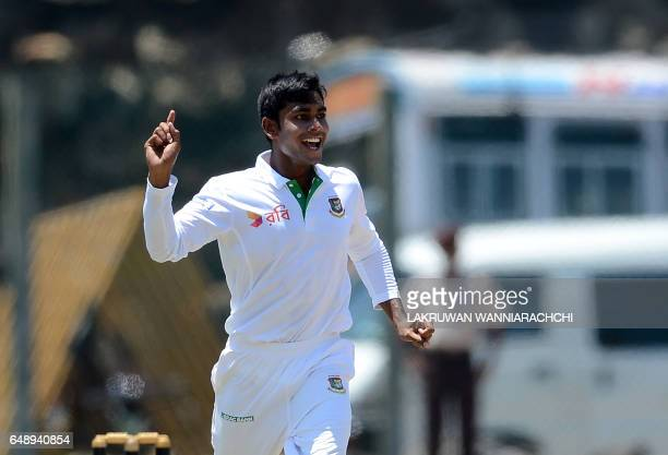 Bangladesh cricketer Mehedi Hasan celebrates the wicket of Sri Lankan cricketer Dimuth Karunaratne on the first day of the opening Test match between...