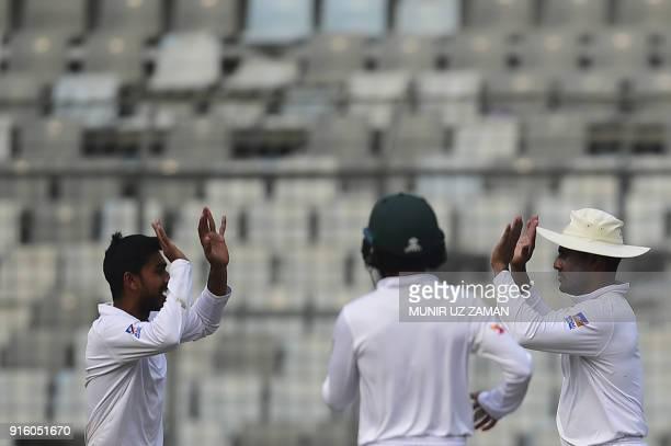 Bangladesh cricketer Mehedi Hasan celebrates with his teammate Imrul kayes after the dismissal of the Sri Lankan cricketer Dimuth Karunaratne during...