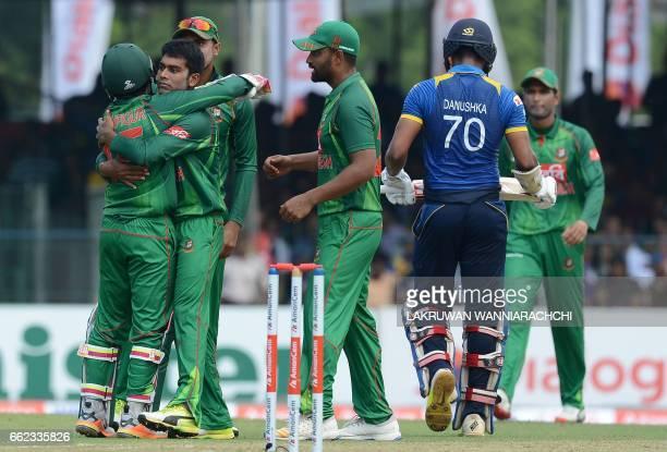 Bangladesh cricketer Mehedi Hasan celebrates with teammates after he dismissed Sri Lankan batsman Danushka Gunathilaka during the third and final one...