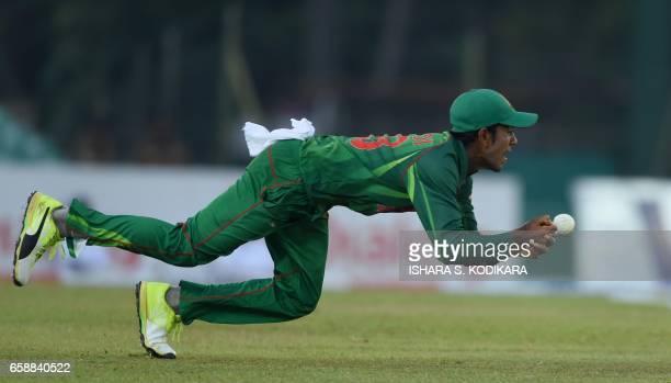 Bangladesh cricketer Mehedi Hasan drops a catch off Sri Lankan cricketer Milinda Siriwardana during the second one day international cricket match...