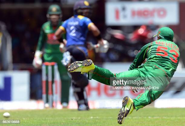Bangladesh cricketer Mehedi Hasan leaps into the air as he attempts to field a ball during the third and final one day international cricket match...