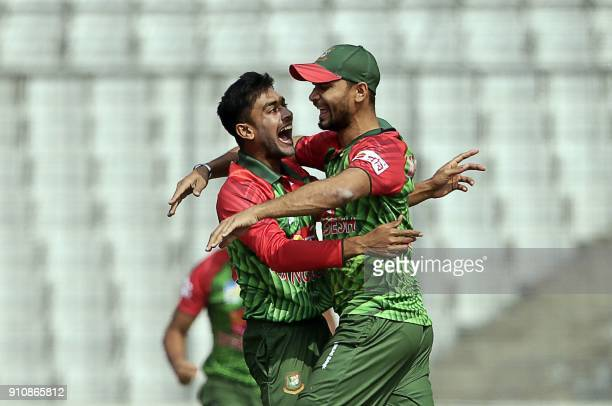 Bangladesh cricketer Mehedi Hasan Miraz celebrates along with captain Mashrafe Bin Mortaza after the dismissal of Sri Lankan batsman Danushka...
