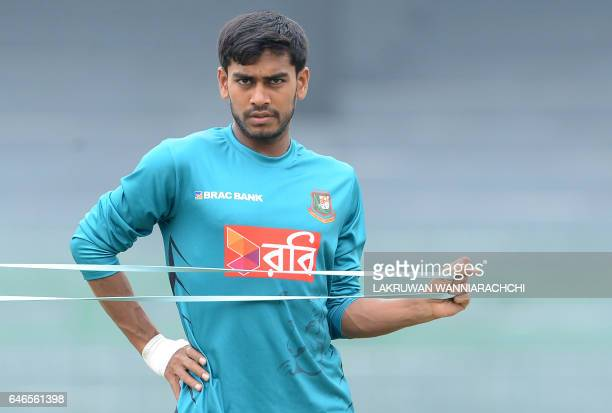 Bangladesh cricketer Mehedi Hasan stretches during a practice session at the R Premadasa Stadium in Colombo on March 1 2017 ahead of a Test series in...