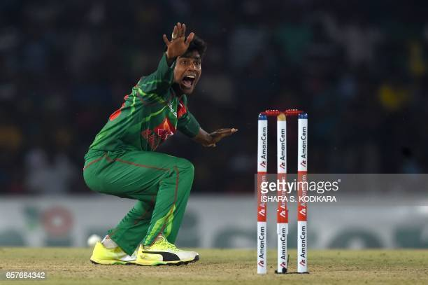 Bangladesh cricketer Mehedi Hasan unsuccessfully appeals for the wicket of Sri Lankan cricketer Dinesh Chandimal during the first one day...