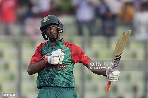 Bangladesh cricketer Mohammad Mahmudullah acknowledges the crowd after reaching his half century during the third oneday international match between...