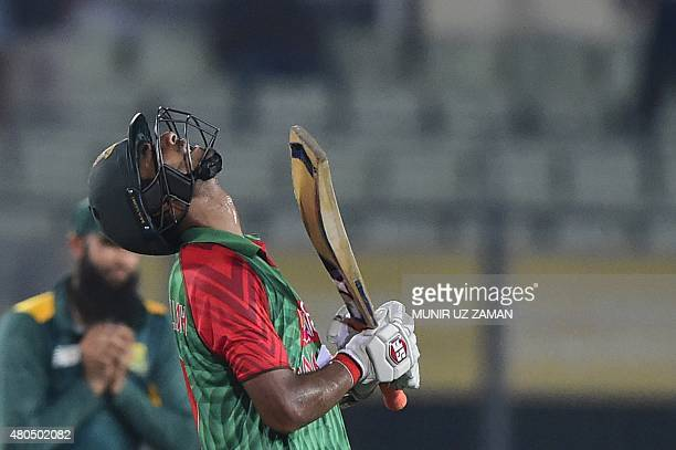 Bangladesh cricketer Mohammad Mahmudullah reacts after being dismissed by South African cricketer Kyle Abbott during the second One Day International...