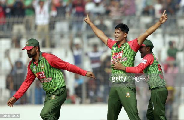 Bangladesh cricketer Mohammad Saifuddin celebrates after the dismissal of Sri Lankan batsman Niroshan Dickwella during the final one day...