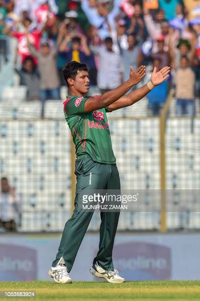 Bangladesh cricketer Mohammad Saifuddin reacts after the dismissal of the Zimbabwe cricketer Cephas Zhuwao during the third one day international...