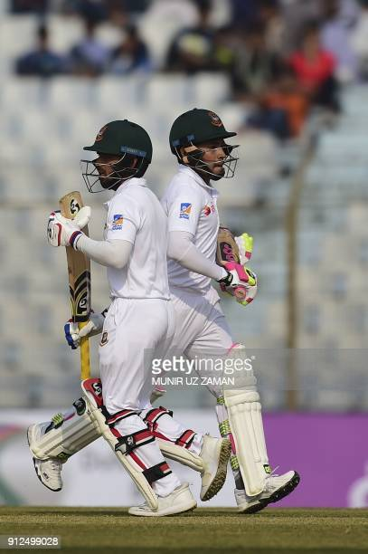 Bangladesh cricketer Mominul Haque runs between the wickets with his teammat Mushfiqur Rahim during the first day of the first cricket Test between...