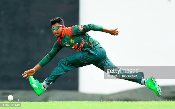 TOPSHOT Bangladesh cricketer Mosaddek Hossain tries to stop the ball during the oneday warmup match between Sri Lanka Board President's XI and...