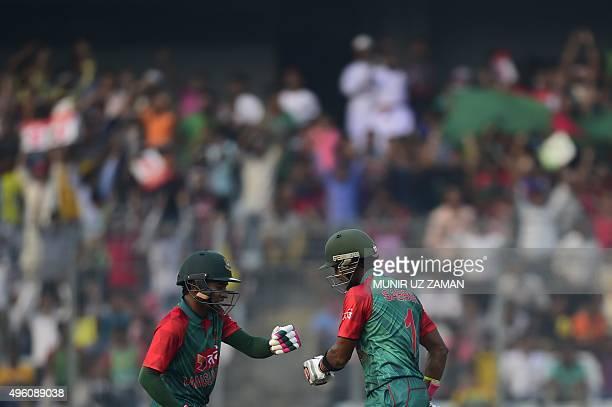 Bangladesh cricketer Mushfiqur Rahim and Sabbir Rahman celebrate a 100run partnership during the first oneday international match between Bangladesh...