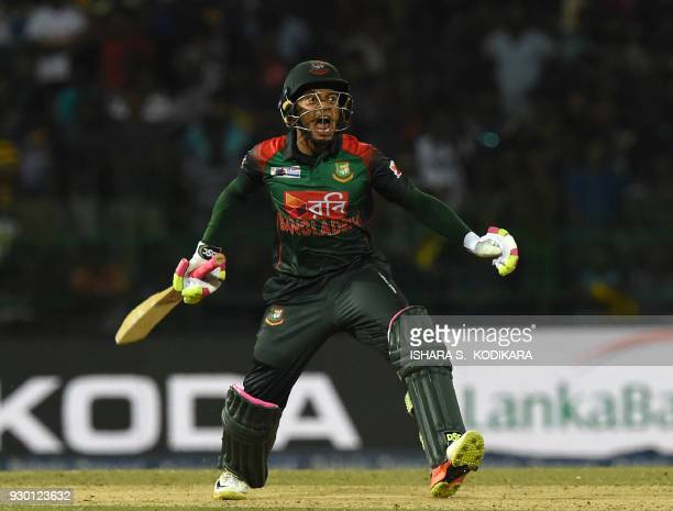 TOPSHOT Bangladesh cricketer Mushfiqur Rahim celebrate their team's five wickets victory over Sri Lanka after during the third Twenty20 international...