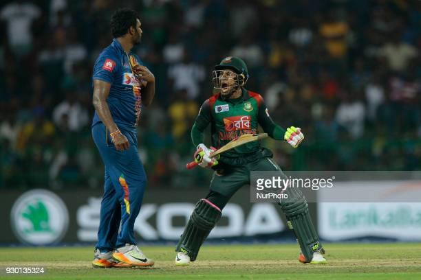 Bangladesh cricketer Mushfiqur Rahim celebrates after scoring the winning runs during the 3rd T20 cricket match of NIDAHAS Trophy between Sri Lanka...